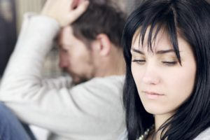 Sad woman not looking upset husband