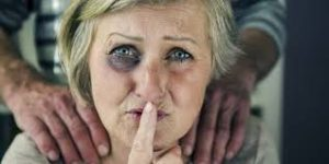 woman with a black eye motioning silence | domestic a buse