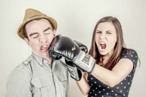 woman punching her spouse