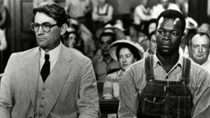 caucasian man next to an african american man in to kill a mockingbird